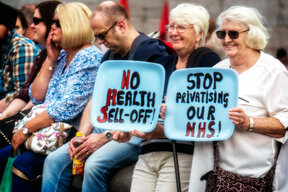 Photo of pensioners protesting holding painted trays: No Health Sell-Off; Stop Privatising Our NHS