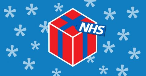 An image of a Christmas present with the word NHS on it, surrounded by stars on a blue background