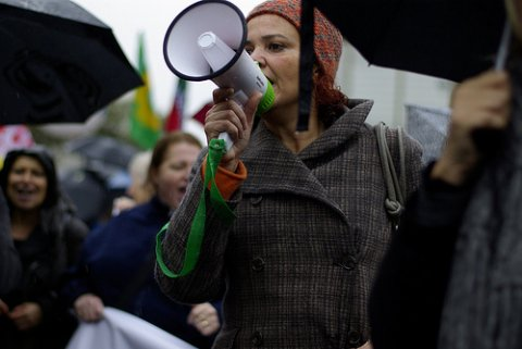Photo of woman with a megaphone in crowd