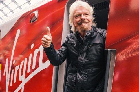 Richard Branson on a Virgin branded train