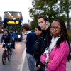 Photo of passengers at a bus stop
