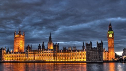 A photograph of the Houses of Parliament at night