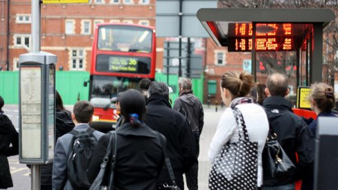 Passengers waiting at bus stop