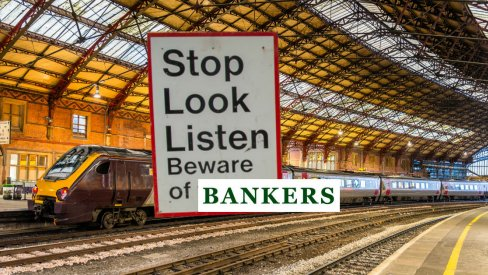 Photo of train station and sign: Stop, look, listen. Beware of bankers