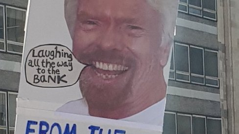 Protect our NHS placard with Branson