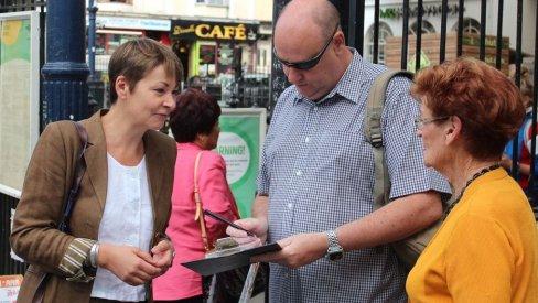 Photo of Caroline Lucas at Brighton station