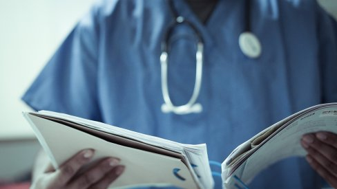 Image of a doctor reading notes