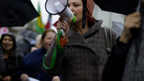Woman with megaphone in a crowd
