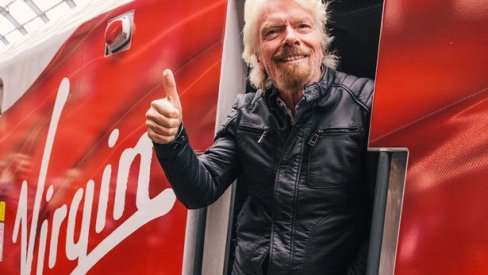 Richard Branson on a Virgin branded train