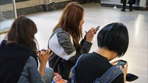 Young women on smartphones