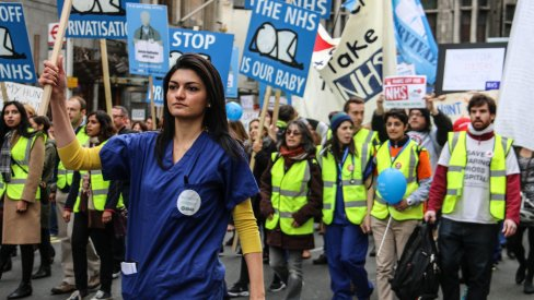 Woman marching at NHS protest, London