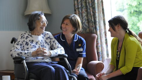 Photo of care worker and older person