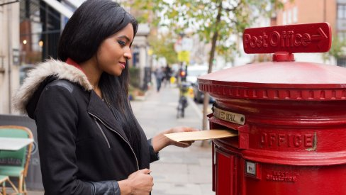 Woman posting a letter