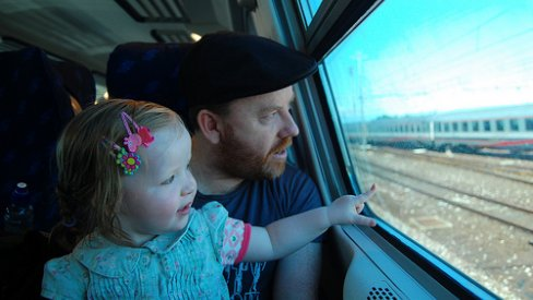 Photo of parent and child on train
